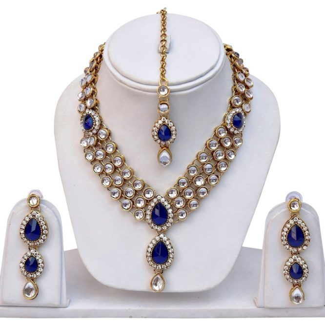 Traditional Kundan Jewellery Set / Necklace Set For Women Made from High Quality Hand Picked Kundan Stone Gold Plated Base Material Perfect Kundan Necklace Jewellery Set for Party Wear Shining Diva is a well known brand across fashion jewelry sector. Shining Diva products are preferred by many Designers, Stars and Celebrities. Shining Diva fashion jewelry believes in making beauty and fashion a part of everybody's life